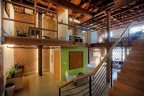home interior warehouse adaptive reuse of a warehouse for office space by studio