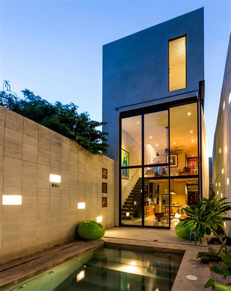 height of design skinny concrete home with double height glass doors
