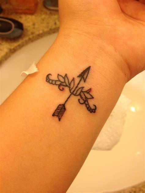 Amazing Bow With Arrow Tattoo On Wrist   Tattooshunt.com