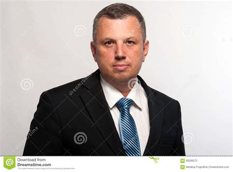 modern suits for middle aged men portrait of a serious middle aged man in a suit stock