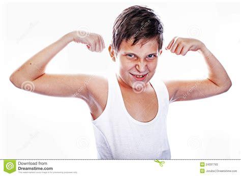 little boy flexing bicep young boy flexing biceps stock photos image 24337793