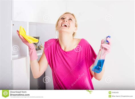 happy houswife cleaning furniture at home royalty free