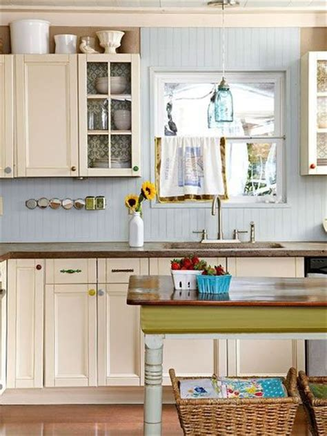 mismatched cabinet knobs and pulls add personality to this