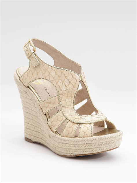 house of harlow sandals house of harlow caged wedge sandals in white gold lyst