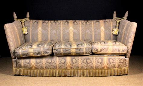 knowle settee a three seater knowle settee the upholstered back hinged s