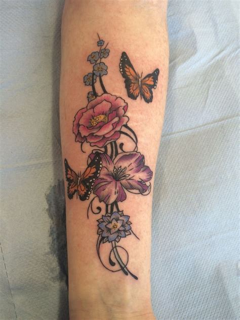 tattoo removal peterborough uk flowers and butterfly by travis allen tattooist