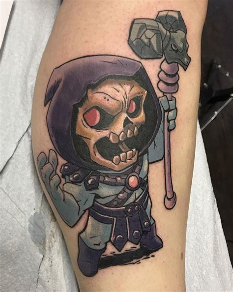 skeletor tattoo skeletor tattooed by squiggy black gold and