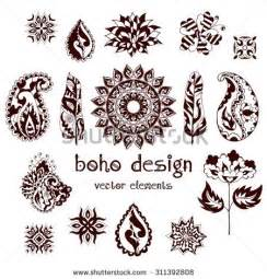 set of ornamental boho style elements feathers mandalas