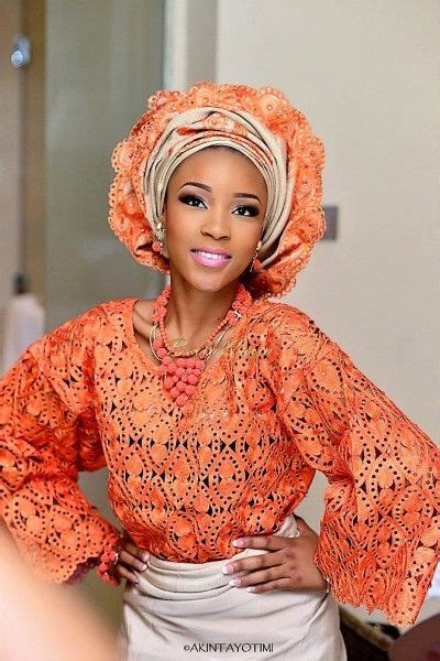 aso oke and lace attires for yoruba traditional weddings nigerian yoruba bride in orange buba top lace gold aso