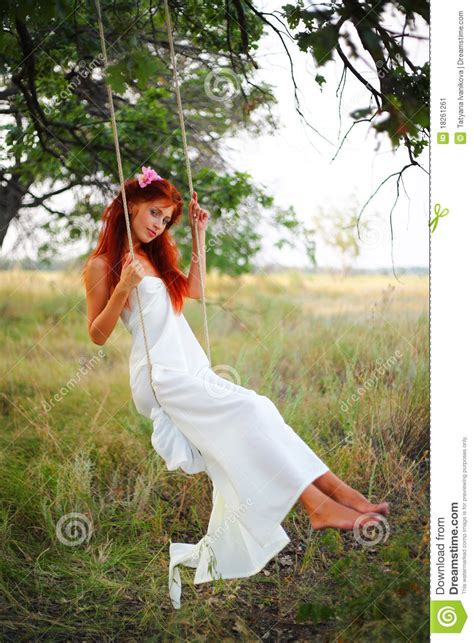 woman on a swing the young girl on a swing stock image image 18261261