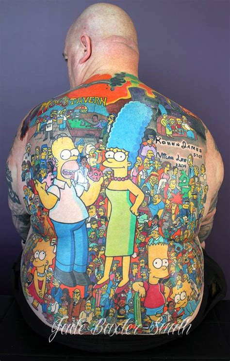 man with massive simpsons tattoo on back holds guinness