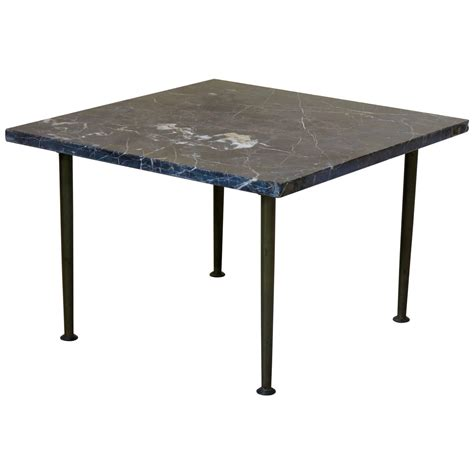 small square bronze and black marble coffee table