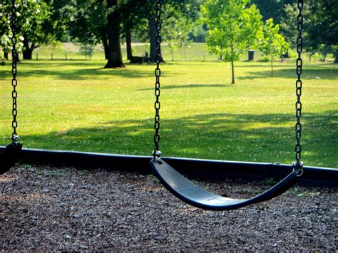 park with swings free photo park playground swing summer free image