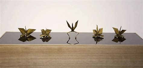 Moving Origami Crane - a flock of synchronized origami cranes on an
