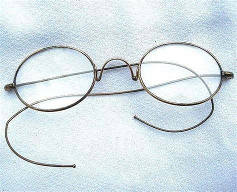 vintage gold wire rimmed oval shaped eyeglasses spectacles