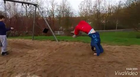 people falling off swings watch how guy s attempt at backflipping off swing ends
