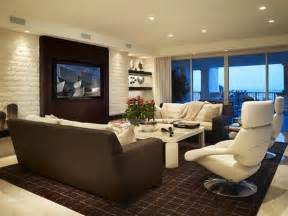 Wall mount tv in brown and beige living room