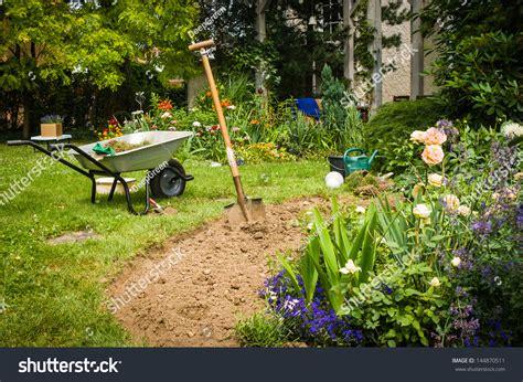 Garden Work by Work In Garden Digging New Flower Beds Stock Photo