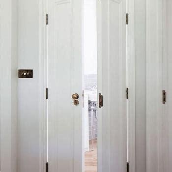 bathroom bi fold door french doors with oval glass door knobs transitional
