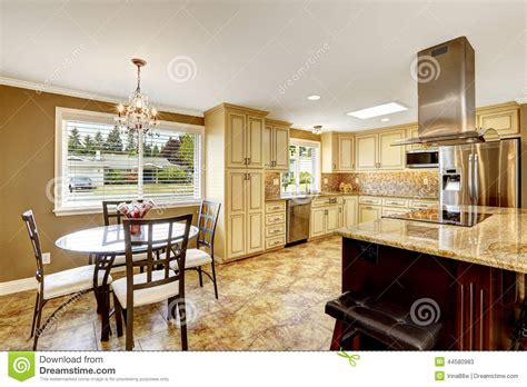 Kitchen Island Plans Free kitchen interior with dining table set and island stock