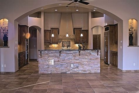 stacked stone compliments  kitchen peninsula custom