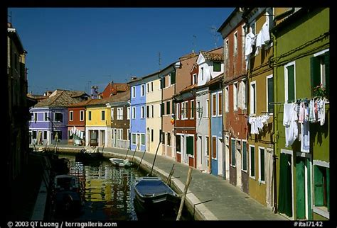 houses in venice italy picture photo canal lined with multihued houses burano