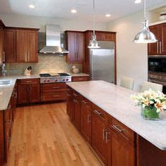 Cherry Cabinets With White Countertops by Kitchen By Tracy Grosspietsch Interiors Wood