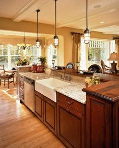 two tier island with sink and dishwasher would prefer what goes with saddle cabinet on pinterest bay window