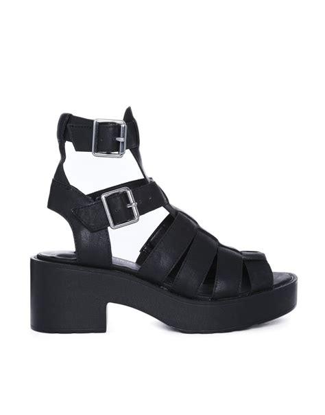chunky gladiator sandals river island black chunky low heeled gladiator sandals in