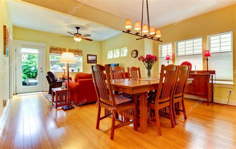 large dining  family room  yellow walls stock