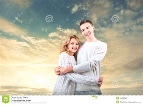 Cauple Senny embracing and holding one another the sky royalty free stock image image