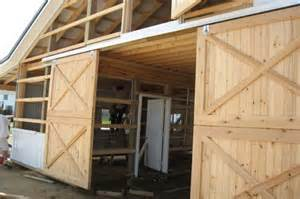 Sliding Exterior Barn Doors Exterior Sliding Barn Door Hardware With Crossed Braces And Unpainted Wood Simply And Homy