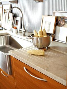 how to clean stained white corian sink transitional kitchen maple black stained shaker door