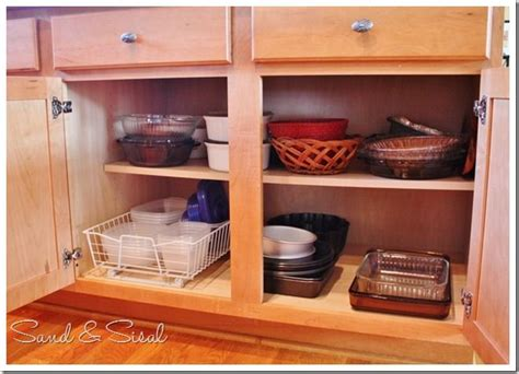 kitchen cabinet organization ideas sand and sisal kitchen cabinet organization taming the tupperware kitchen cabinet