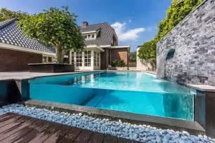 Modular Raised Garden Beds - visually stunning infinity edge pool with glass wall favething com