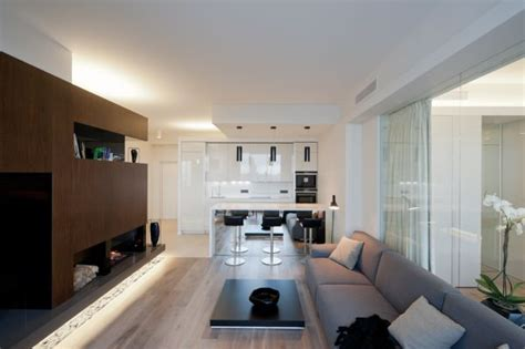 window between kitchen and living room an ultra modern moscow apartment with a glass wall between
