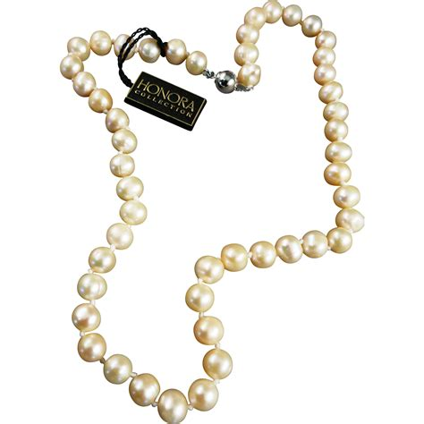 Vintage String - vintage honora knotted string of pinkish freshwater pearls