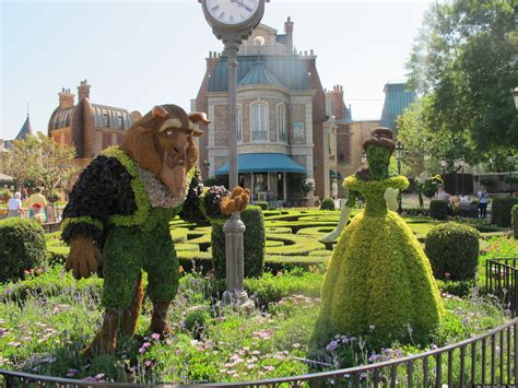 disney characters come to as topiaries at epcot photos huffpost