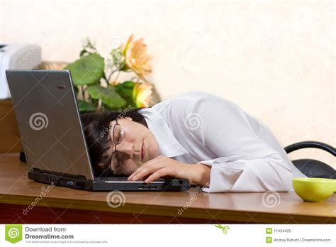 businesswoman sleeping on the desk royalty free stock