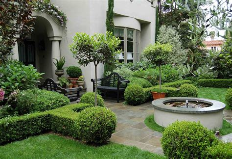 ravishing tuscan style front yard landscape garden with trimmed shrubberies and a fountain artenzo