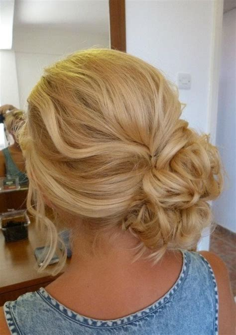 1000 ideas about curly bun on curly bun buns and curly hair