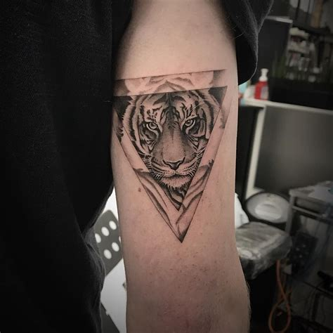 tricep tattoo designs tiger triangle on tricep