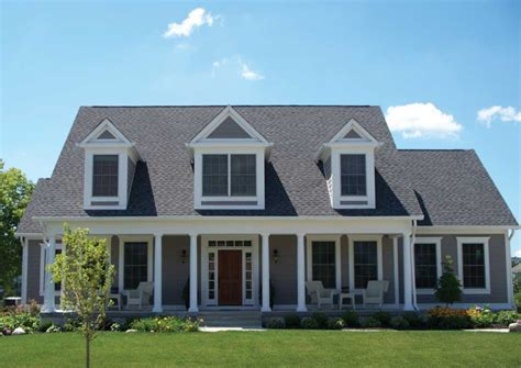 cod homes beautiful gray cape cod style home with white windows
