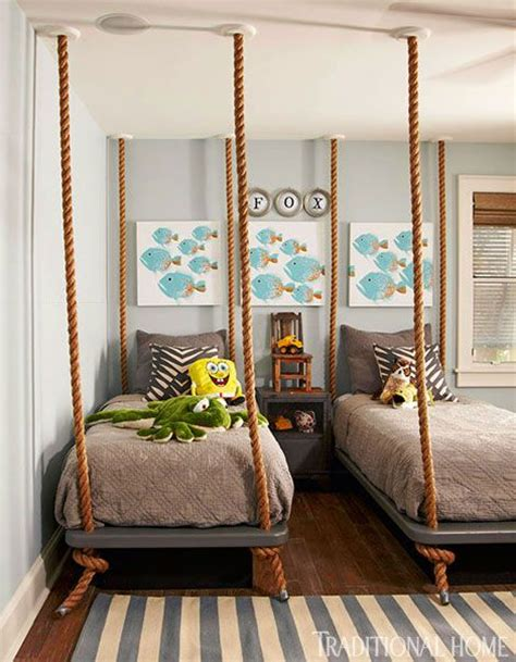 beds that hang from the ceiling a pair of twin beds appear to hang from the ceiling by