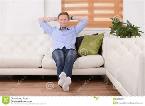 couch sitting doing nothing at his day off cheerful young men sitting