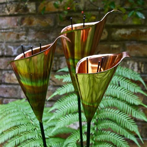 copper lily garden sculpture by london garden trading