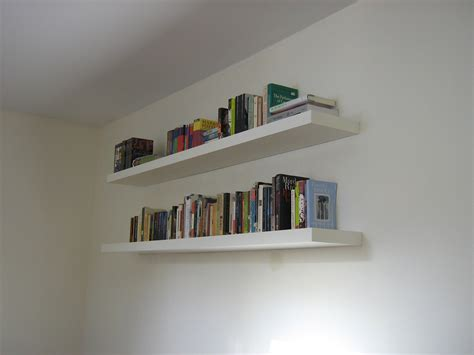book rack designs for bedroom double long white wooden wall shelves on white wall of