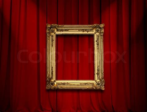 frame and curtain wall empty golden painting frame on red curtain wall stock