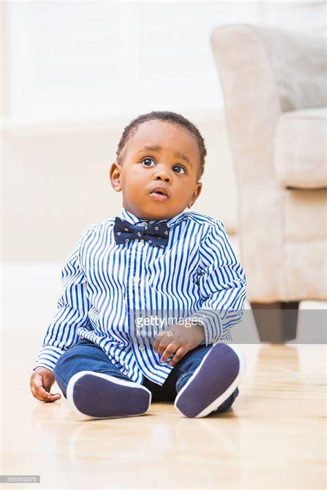 photos of black toddlers boys black baby boy sitting on living room floor stock photo