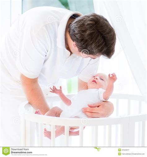 Putting Baby In Crib Happy Putting His Newborn Baby In Crib Stock Image Image 41544077